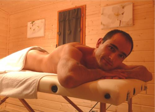 A gay masseur performing a massage